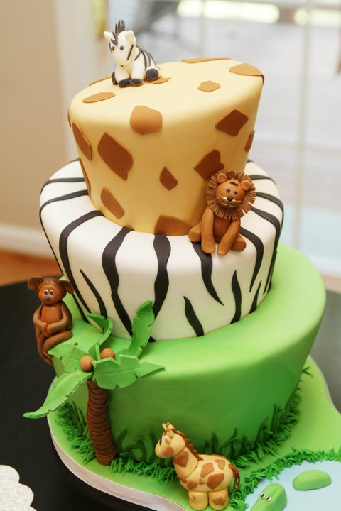 Safari topsy turvy - Done for an adorable little boy on his first birthday! Figures handmade in fondant. The board was cut to be a part of the design and incorporate the little pond. Cake flavors were Cappuccino Tiramisu (obviously for the parentslol) and apple pie cake. Thanks for looking and thanks to all those on cc who have made safari cakes ahead of me that inspired this cake. Have a blessed day!