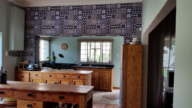 Oregon kitchen with newly installed Susy Amoils geometric tile wallpaper.