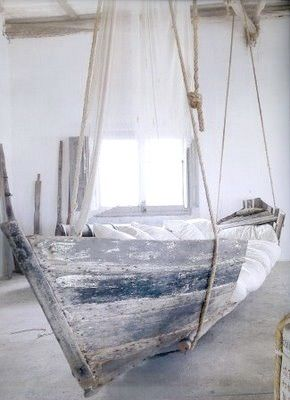Another lovely ship bed, this one suspended from the ceiling. Hovers only a few feet off the ground, but still an amazing effect. Bleached white is a nice transition. Or for a vacation house!