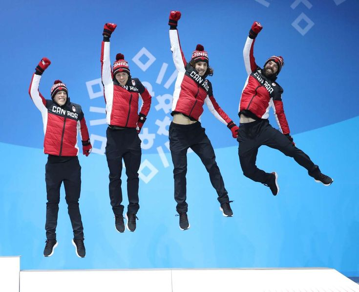 2018 Winter Olympics - Third-placed team Canada celebrate during the medal ceremony for the men's 5000m relay of short track speed skating on Feb. 23, in PyeongChang, South Korea.