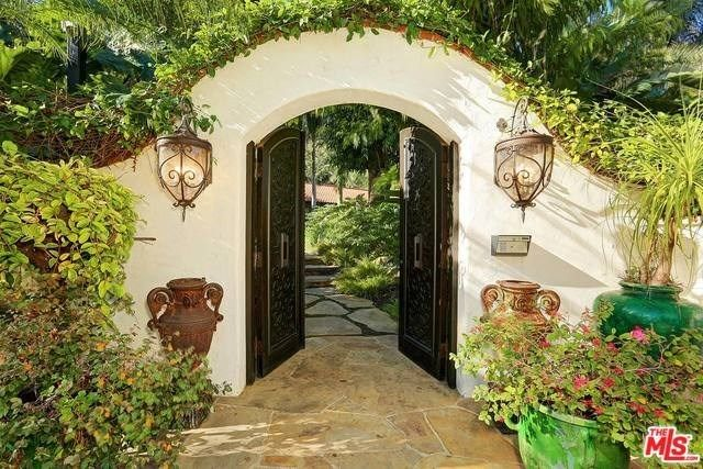 """23155 Mariposa De Oro Street. Extremely private, serene, & gated Serra Retreat home has a magical spa-like resort feel that can't be duplicated. A one story home, sprawling over a """"40,000+"""" parcel, has been completely modernized & remodeled to absolute top standards."""