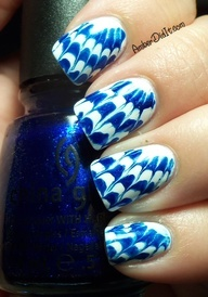 Needle pull on wet dots give this tie dye look - white cream base with China Glaze sparkle blue glass fleck - think of Drinking My Blues Away or Blue Years Eve
