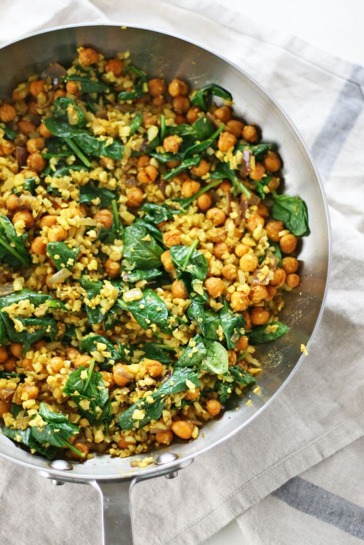 Swap traditional white rice for riced cauliflower in this curry cauliflower fried rice recipe with roasted, crunchy chickpeas and warming flavors.