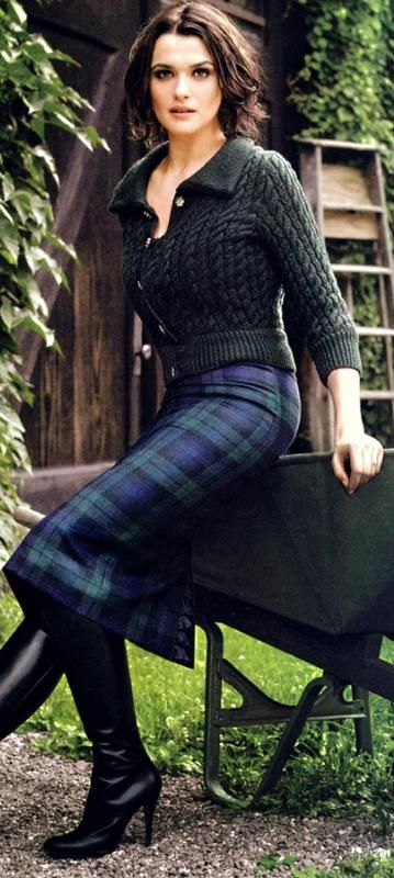 Rachel Weisz in a Green Knit Sweater + Tartan Plaid skirt.