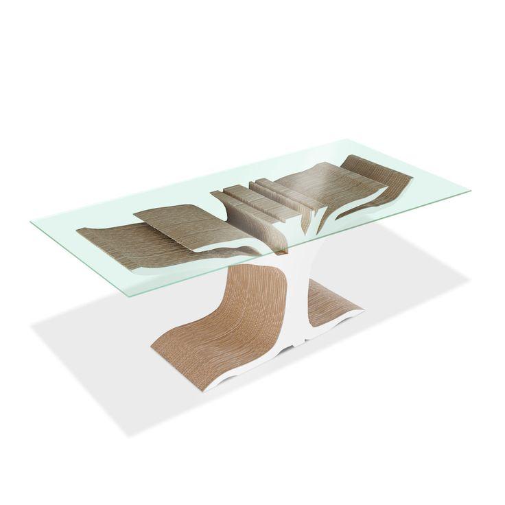 Il tavolo in cartone Floyd è realizzato con fogli di cartone ondulati stratificati, alternando il senso delle onde per conferire al prodotto una maggiore resistenza, ed un'estetica più accattivante. Pannello in vetro temperato. Ecologico, sostenibile, riciclabile.