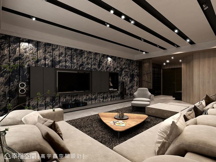 自然、粗獷感的石材拼接出整面電視牆,不加修飾的視覺美感帶來恢弘的室內氛圍。