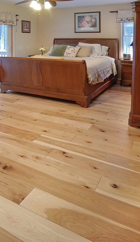 Wide plank hickory flooring with Ozark prefinishing.