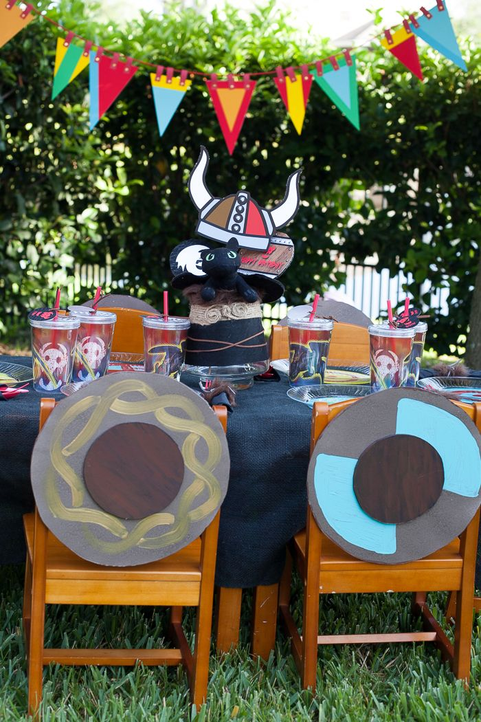 We are definitely doing shields as decor. I also like the face painting in this party. // How To Train Your Dragon Party