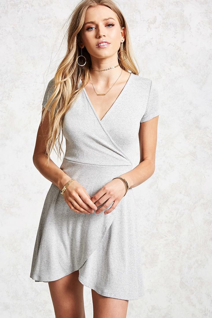 Style Deals - A heathered knit dress featuring a surplice V-neckline, mock wrap skirt, short sleeves, tulip front hem, and a skater silhouette.