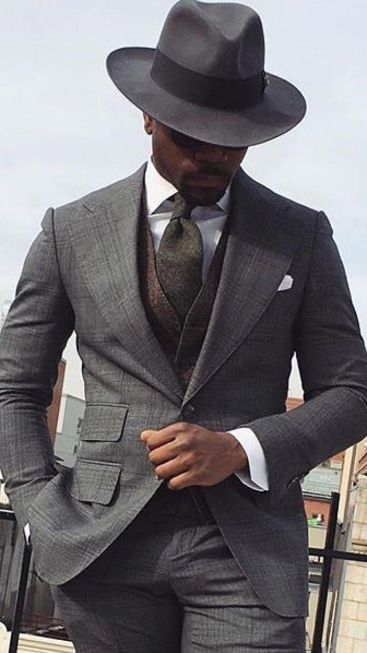 4b21724bcb Dapper combo inspiration with a gray wide lapel suit charcoal gray  waistcoat white button up shirt graphite tie black fedora white pocket  square. model ...