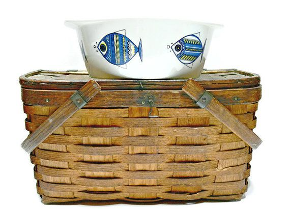 This vintage porcelain Danish modern casserole or baking dish in the whimsical blue and white Viking fish pattern was designed by Christine Reuter and made by the distinguished Villeroy and Boch company,Luxenbourg.
