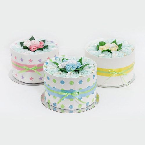 The Petite Range -   The petite nappy cake is an adorable gift, perfect for the arrival of a new baby or as a baby shower gift.  Each cake is presented with a gorgeous arrangement of sock flowers in the center of each cake.