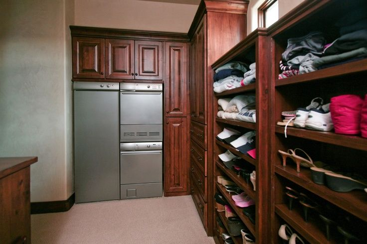 ASKO's washer and dryer stacked along side a drying cabinet in the closet. Closets are the perfect place to do your laundry! Your dirty clothes are already there!