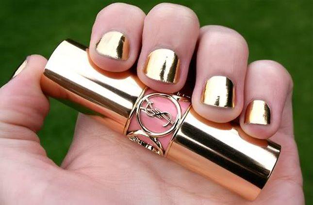 YSL gold nail polish .