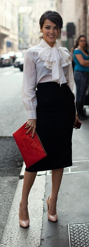 Work clothes with a frou-frou blouse with simple black below-the-knee skirt.