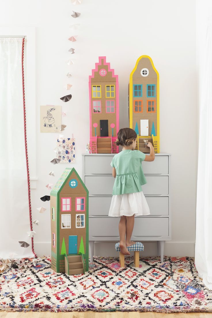 DIY cardboard brownstone houses with washi  tape from Merrilee Liddiard's book PLAYFUL. Photography by Nicole Gerulat #playfultoysandcrafts #washitape Shop on line: www.mywashitape.com