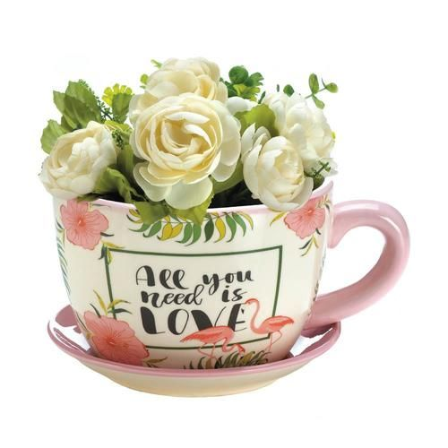 """If plants are your cup of tea, this is the planter for you! Put a plant inside this tropical teacup planter and enjoy the charming flamingoes, beautiful flowers, and the popular phrase """"All you need is LOVE"""". Material(s):DOLOMITE 8.25"""" x 6.75"""" x 4.5"""""""