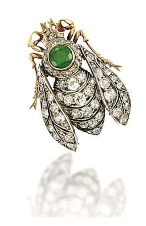 A LATE 19TH CENTURY DEMANTOID GARNET AND DIAMOND INSECT BROOCH Modelled as a bee, the pierced abdomen and wings entirely set with old and rose-cut diamonds, to the circular-cut demantoid garnet thorax with rose-cut diamond surround, the head with ruby single-stone eye detail, mounted in silver and gold, circa 1890, 3.5cm long
