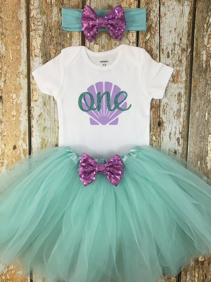 "This adorable ""One"" mermaid birthday outfit is the perfect first birthday outfit for your little girl to wear at her party or for a cake smash photo shoot!"