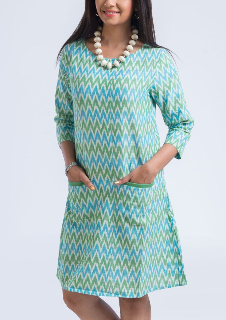 The beautiful hues of aqua green creating a magical weave illusion is somethng so fresh and trendy you can not take your eyes off so buy this cotton blue ikat straight dress for this summer..