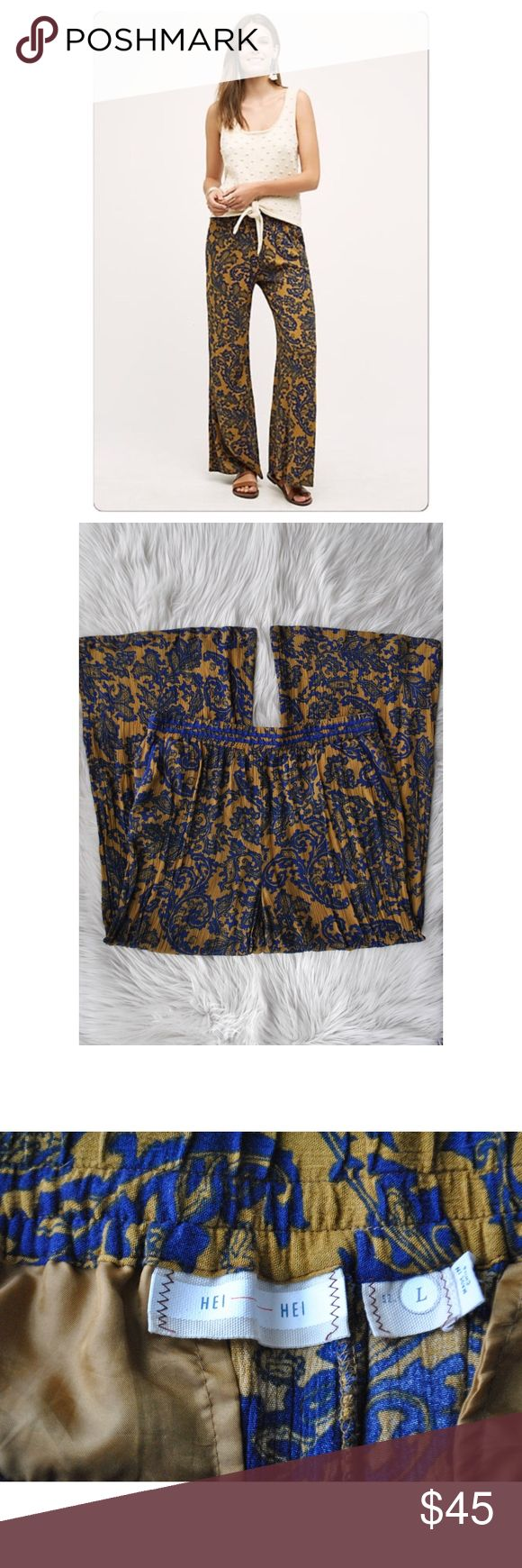 """Anthropologie   Hei Hei Tana Wide-Leg Pants Sz Lg Anthropologie   Hei Hei Tana Wide-Leg Pants Sz Lg. Beautiful vibrant colors of gold and blue. Elastic waist band for stretch. Wide leg makes for a breezy, lightweight feel.   Waist: 32"""" around, I stretched Hip: 46"""" around Inseam: 29""""  All measurements are approximate and should be measured against something you already own to determine how they will fit you. Anthropologie Pants Wide Leg"""
