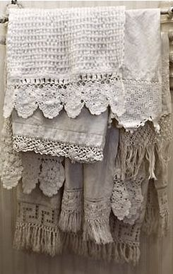 Vintage Lace-edged Towels hanging on a Rail ....