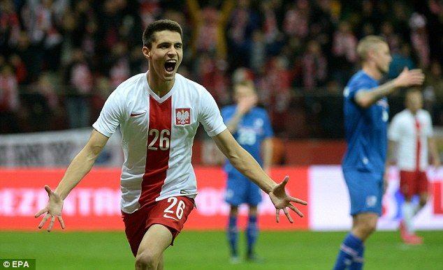 Bartosz Kapustka celebrates after scoring to hand Poland a 2-1 lead over Iceland
