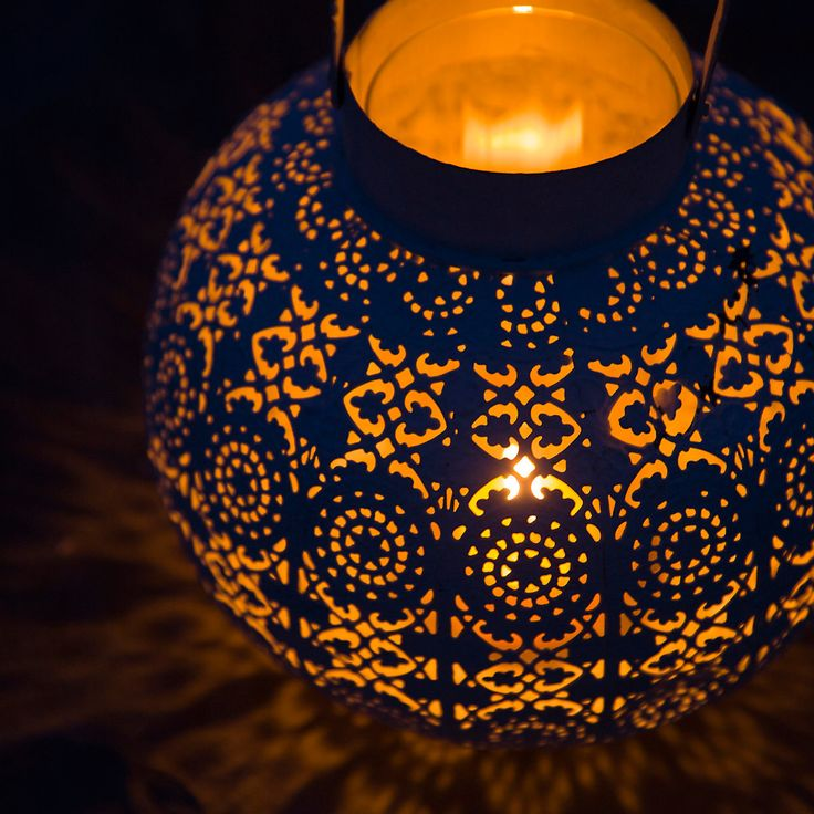 Fill with potpourri, paint either a metallic, navy blue or ivory and put a battery-operated candle or battery-operated LED lights inside