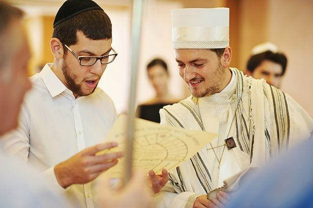 Traditional Jewish bessings readings. Stella and Moscha Weddings. Photo by Thanasis Kaiafas