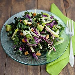 Healthy, vegan, crunchy and fresh.  Kale salad with cabbage, apple, avocado, nuts, and dried currants.