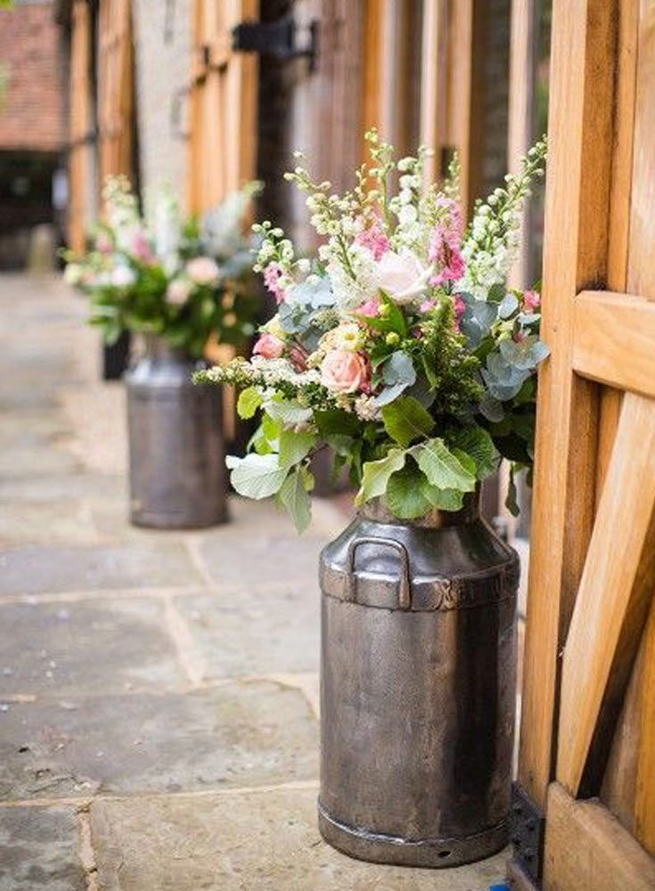 the French Bedroom Company Blog, Meet The Floristas - we interview our favourite local florists for their top tips on getting perfect wedding flowers and bridal bouquet. With Forage Flowers and Tigers to Lilies.Milk churn filled with flowers for a wedding - pink roses and white stocks flowers, country wedding