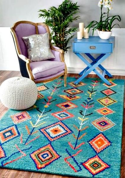 This hand-tufted wool area rug features a striking geometric pattern which lends itself to both Southwestern and/or Boho/Moroccan decorating. This soft a plush area rug was meticulously handcrafted to