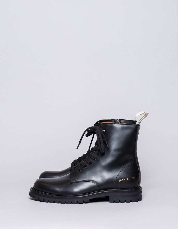 Winter combat Boot from Common Projects. Premium calf leather construction with commando sole. Leather welt, zippered insides, gold stamped branding and coated metal hook lacing.    Black  Made in Italy