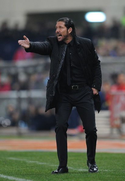 Coach Diego Simeone of Club Atletico de Madrid reacts during the La Liga match between Club Atletico de Madrid and FC Barcelona at Vicente Calderon Stadium on January 11, 2014 in Madrid, Spain.