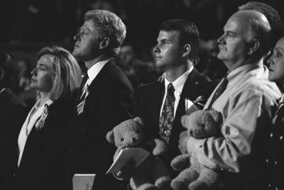 President Clinton and First Lady Hillary Rodham Clinton stand alongside relatives of individuals whom died in the bombing of the Alfred P. Murrah building, 4/23/1995.  Photograph from the William J. Clinton Presidential Library.