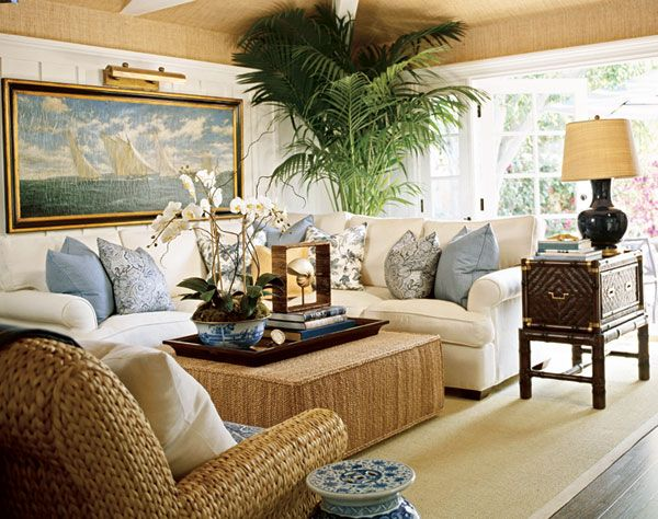 High ceilings create an open space for an organic-hued coastal family room, rife with grasscloth and raffia - Traditional Home®