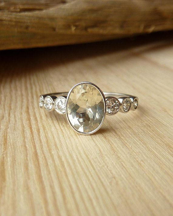 Bold but delicate. This ring encompasses a strong but elegant look by using an approx. 1ct (8x6mm) bezel set gemstone of your choice. centered