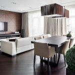 Kiev Apartment by Soesthetic Group Interior Area Showing Cream Sofas Also Wooden Dining Table On The Bottom from Chandeleir