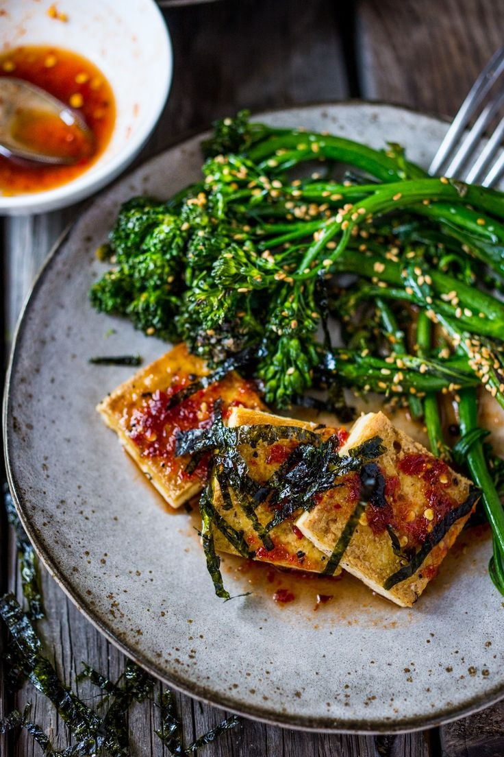 A Tasty recipe for Garlic Chili Tofu with Sesame Broccolini- a delicious and fast, 15 minute dinner that is vegan and gluten free. Healthy & Yummy!   www.feastingathome.com