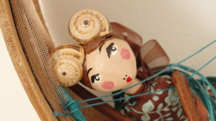 Pormenor de uma boneca da Paula Estorninho: a boneca peneirenta.