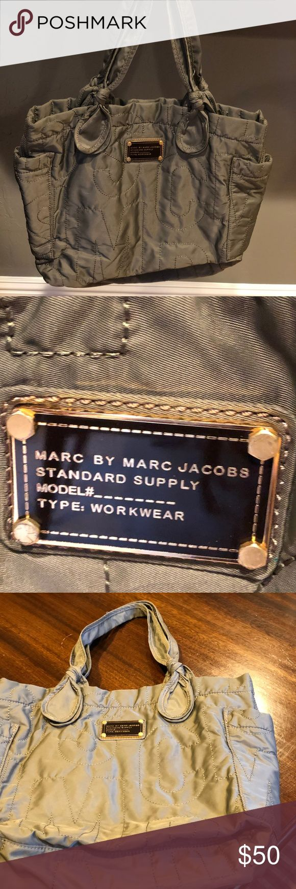 Marc by Marc Jacobs Grey Tote Bag Great tote bag.  Light wear... very clean but there are a few spots on the bottom (inside) of the bag.  Tried to take pictures, but hard to see. Overall in very good condition. Marc By Marc Jacobs Bags Totes