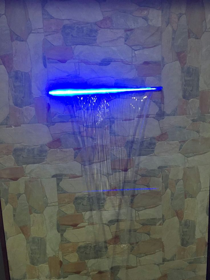 PHOTO 5: The concrete fountain presents a very high quality look, the colours added on the concretes is matching one and the other. The blue light fitted on brings out an even better and fascinating feel.