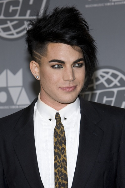 Adam Lambert has got style! Punk emo  hair style, earring, suit, leopard tie,..