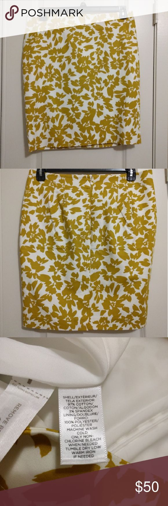 Ann Taylor Mustard & White Floral skirt Knee-length petite skirt in mustard and white floral pattern. Zips in the back. New with tags. LOFT Skirts Pencil