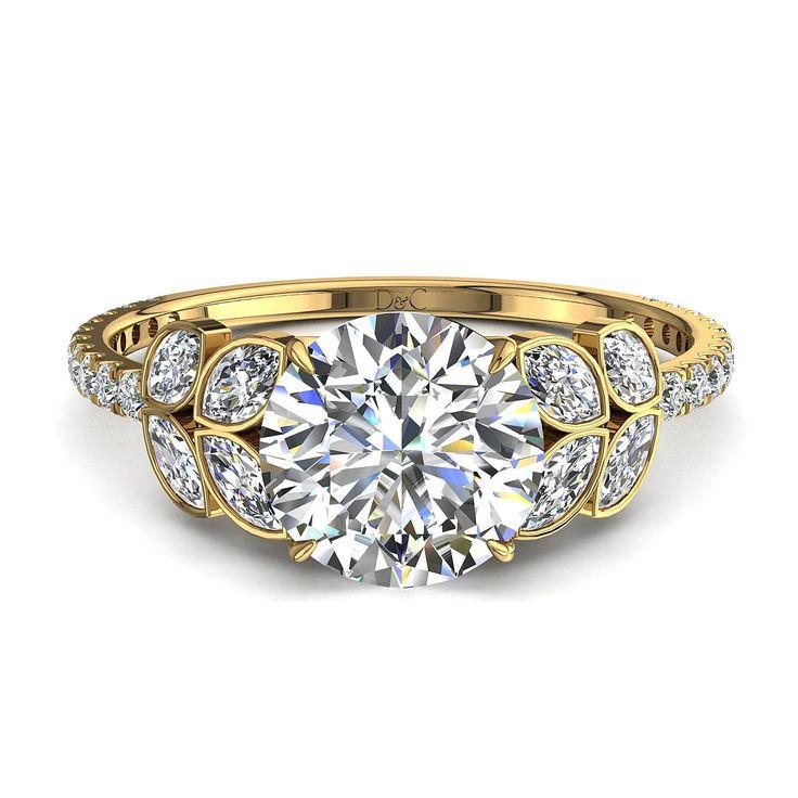 Bague de fiançailles 1,30 carats solitaire diamant femme en or jaune Angela  Angela, belle bague de fiançailles pas chère diamant rond en or jaune. Cette bague diamant 1,30 carats or jaune est sertie d'un diamant central de 0,70 carats. La particularité de ce solitaire diamant 1,30 carats est que la pierre centrale est entouré de 8 marquises de 0,30 carats environ. Cette belle bague de fiançailles diamant que nous fabriquons dans nos ateliers est montée sur de l'or blanc, jaune ou rose 18…