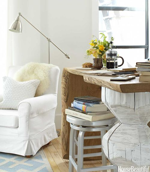 """""""Every home needs those little moments,"""" Lyndsay Caleo says. """"Who doesn't love curling up in a cozy chair?"""" Ikea's Ektorp Jennylund chair comes with a machine-washable slipcover. Barometer lamp by Ikea.   - HouseBeautiful.com"""