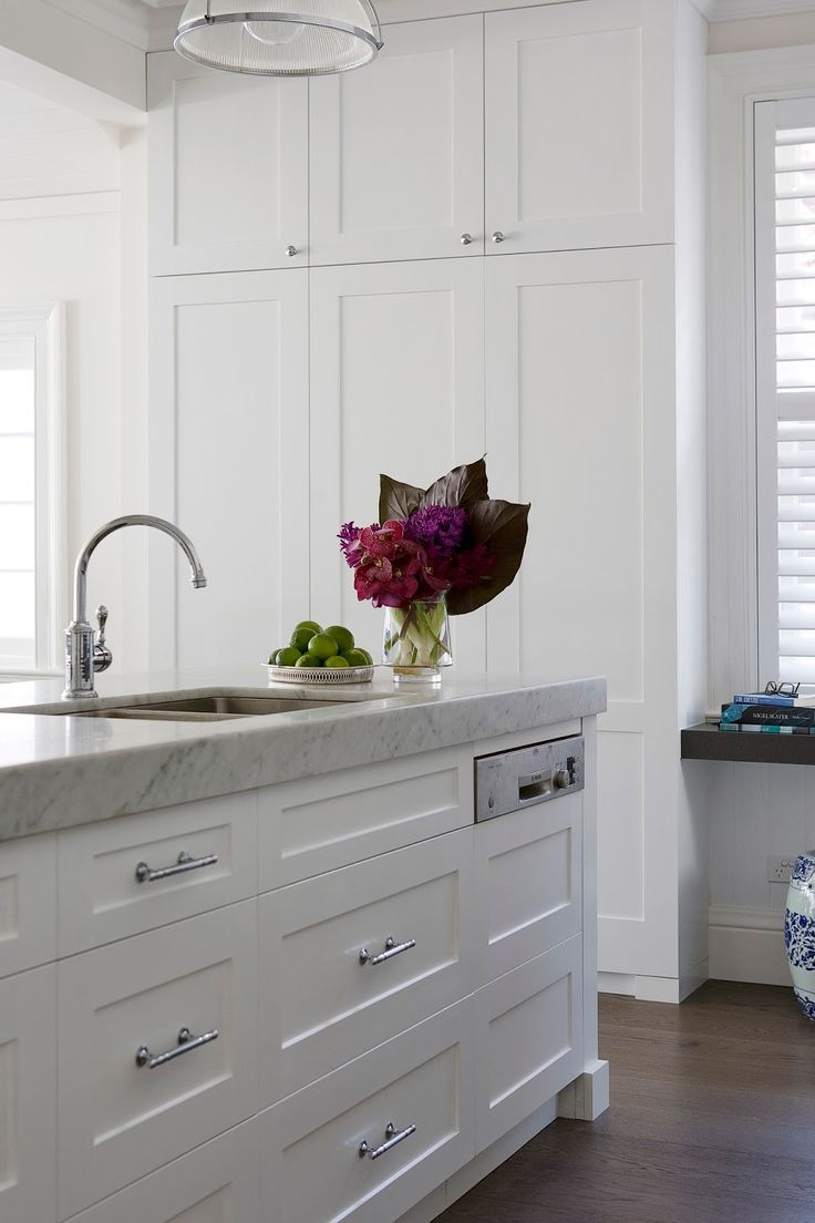 Beautiful white on white #kitchenremodel! I would love my kitchen to be this classic. www.remodelworks.com