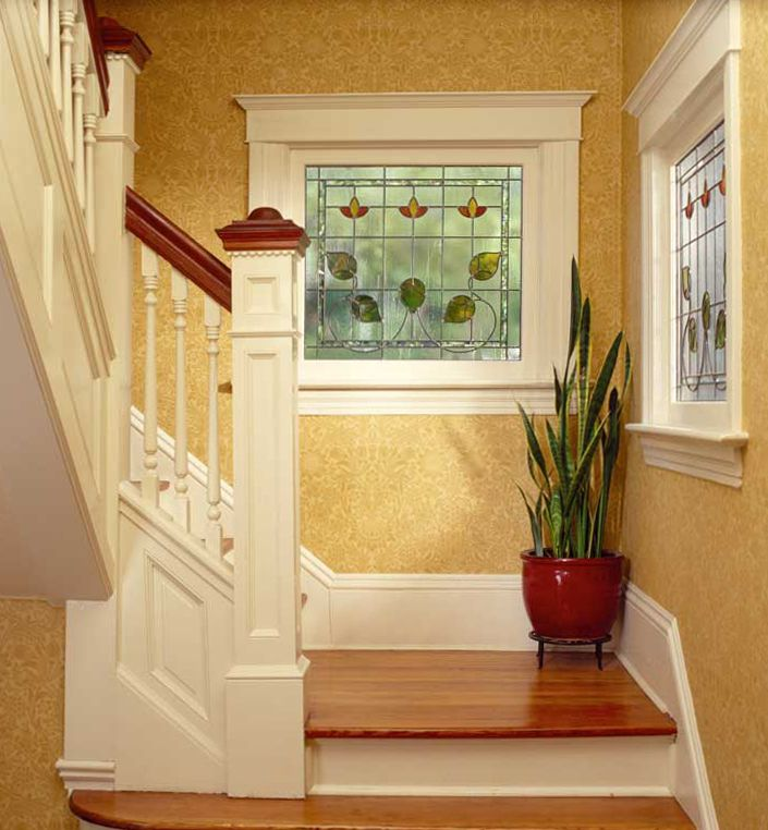 Sanderson's 'Sunflower' paper is illuminated by a stained glass window in the stairwell.