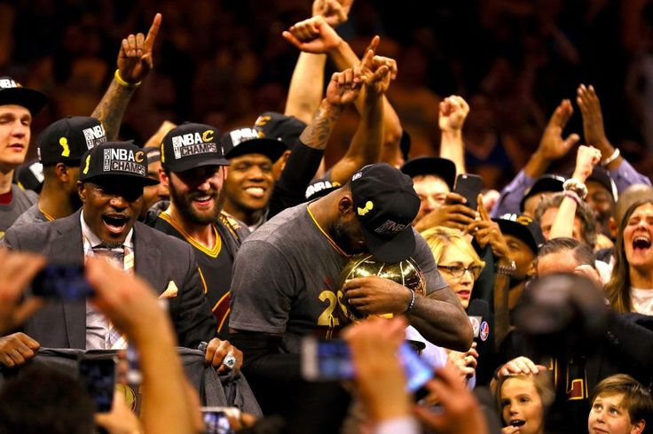 LeBron James, #23 of the Cleveland Cavaliers, holds the Larry O'Brien Championship Trophy after defeating the Golden State Warriors 93-89 in Game 7 of the 2016 NBA Finals at ORACLE Arena in Oakland, Calif., on June 19, 2016.