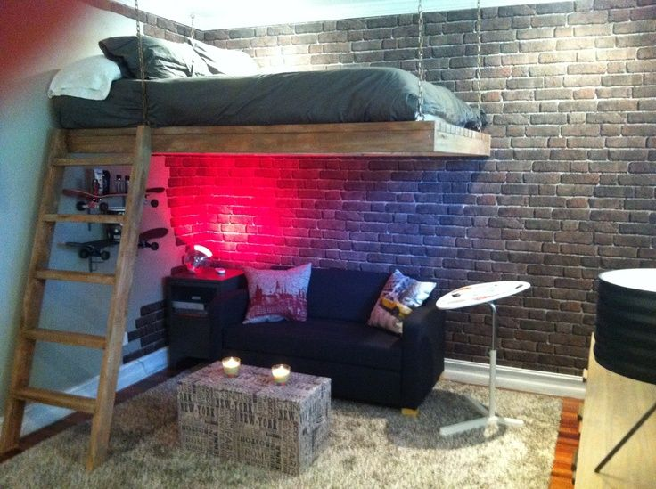stripped and edgy bedroom with exposed brick wall